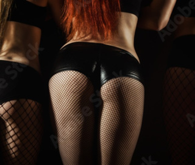 Ass Of Three Beautiful Go Go Dancers In Black Shorts
