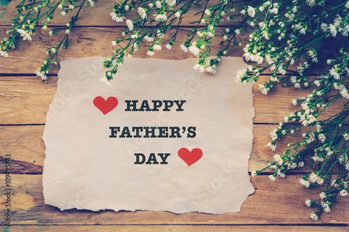 """Happy Fathers day on brown paper with white flower on ..."