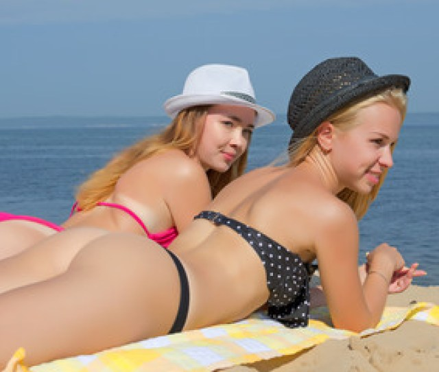 Girls In Thongs On The Beach