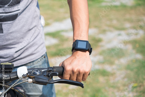 """""""Close-up smart watch on arm women to ride a bicycle ..."""