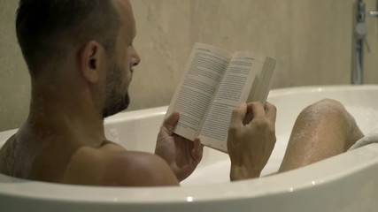 Image result for man reading in the bathtub
