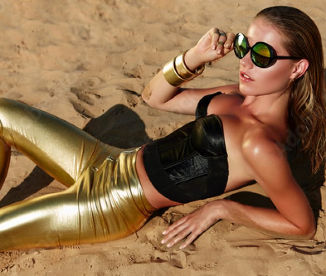 Tanned Girl On The Sand In Sun Glass With Wet Hair And Gold Jewelry Tanned