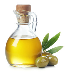 olive oil in a bottle jur and green olives with leaves