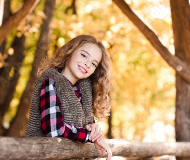 Smiling Teen Girl 13 14 Year Old Posing Outdoors Looking At Camera Spring Season