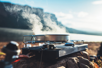 camp stove cooking, What are The Benefits of Using A Camp Stove on An Outing Vs A Charcoal or Wood Fire?