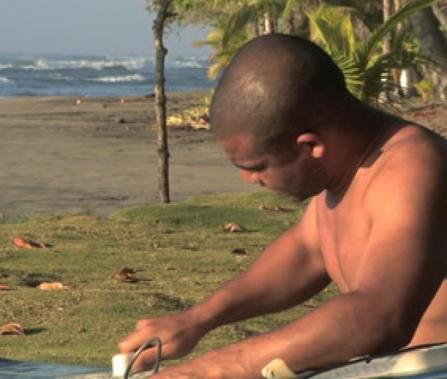 010 Man Waxing His Surfboard