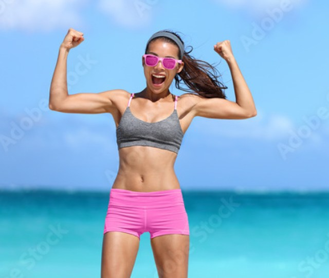 Strong Fitness Woman Showing Off Muscular Arms Flexing Biceps For Fun On Beach Fit Girl
