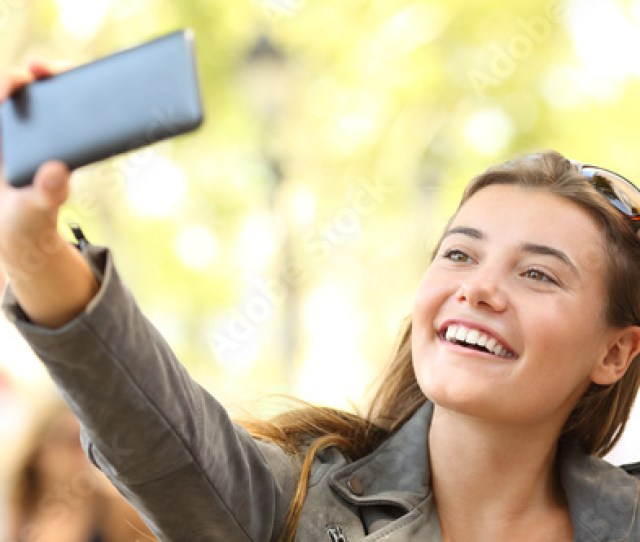 Fashion Teen Taking Selfies On The Street