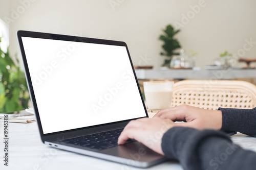 Mockup Image Of Hands Using And Typing On Laptop With Blank White