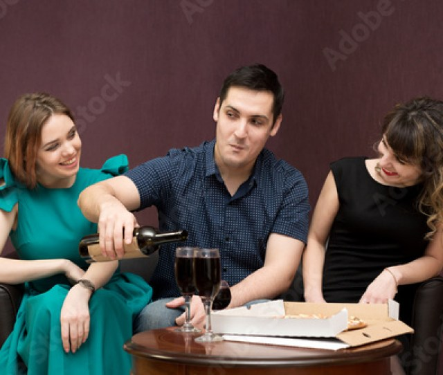 One Man In The Company Of Two Women Party Alcohol Girls Seduce A Man Having Fun And Drinking Wine Eating Pizza Stock Photo And Royalty Free Images On