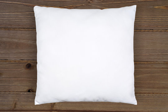 https stock adobe com sk images white throw pillow mockup on rustic brown wood 329201782 start checkout 1 content id 329201782