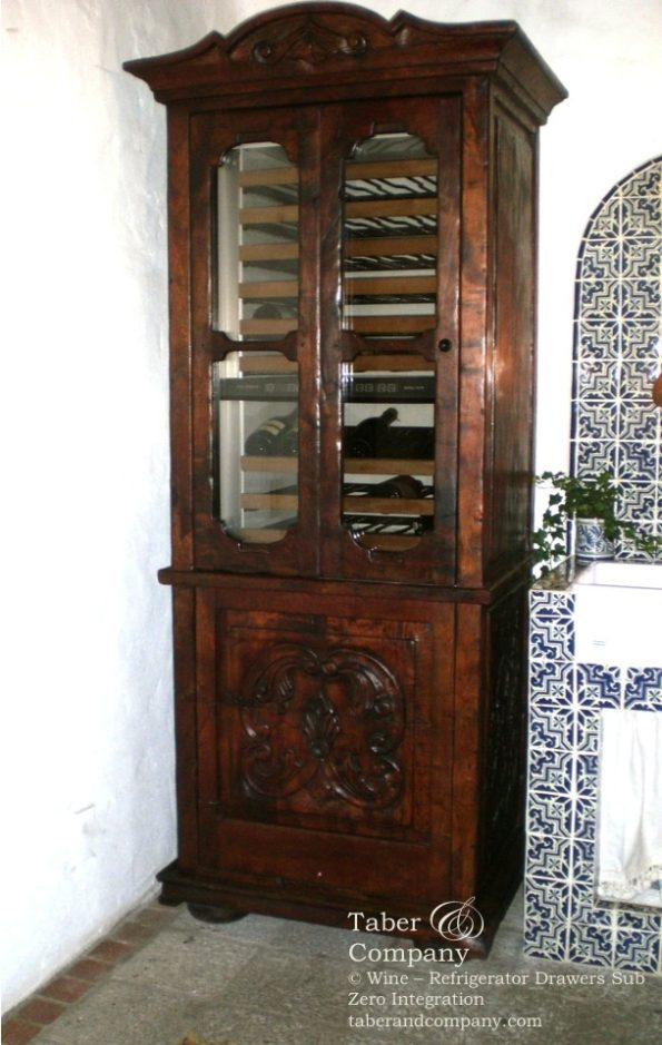 handcrafted custom kitchen islands Sub Zero wine cabinet with refrigerator drawers custom built into a Spanish Mediterranean style custom cabinet.