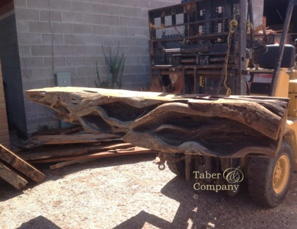 A fallen mesquite log with amazing character becomes a one of a kind fireplace mantel.