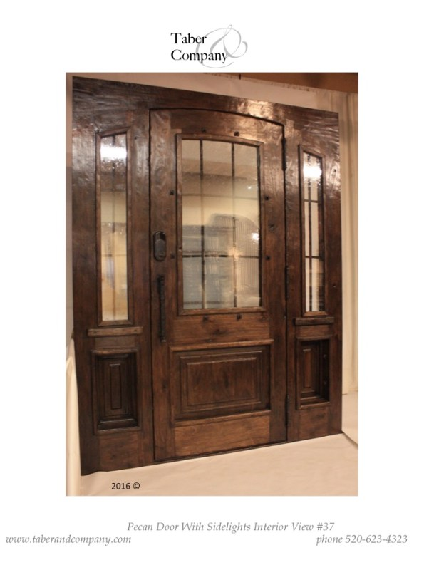 Unique wood entry door with sidelights. Arched top wooden entry door with operable sidelites.