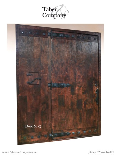 massive solid wood entry door with iron. 10' wooden entry door with iron for mountain home.