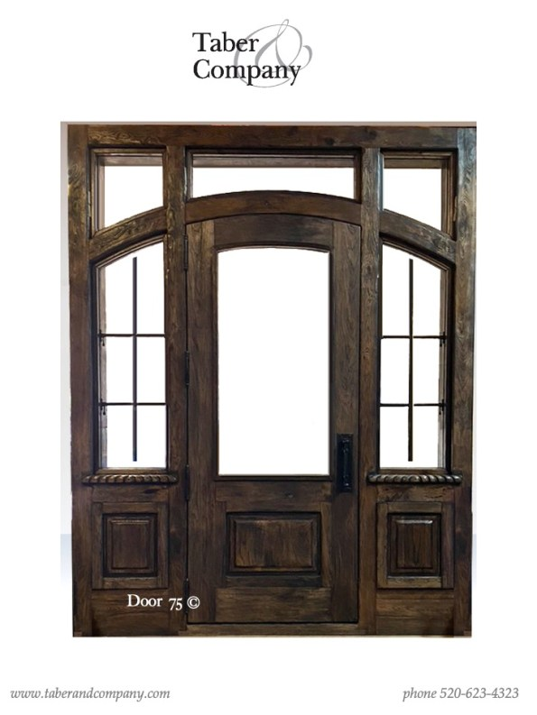 10' wood door with with sidelites transom for a luxury mountain home. Massive wooden entry door with sidelights transom mountain style home