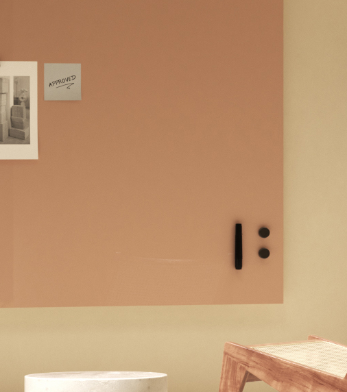 Blush colored whiteboard with magnets and notes