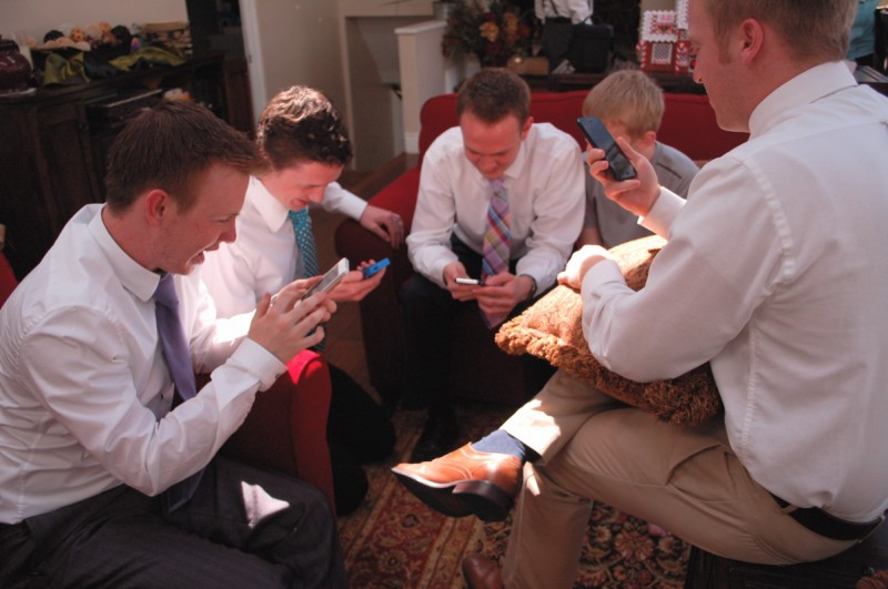 Young Men playing SpaceTeam app on their phones