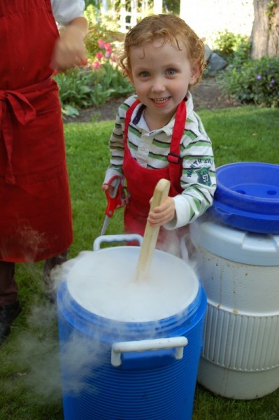 One of Grandma Joyce's younger helpers stirs the homemade rootbeer