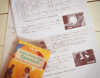 Spanish homework and a Latin American phrasebook and dictionary