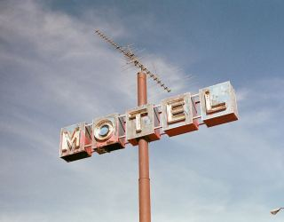 A motel signn which is old and rusty