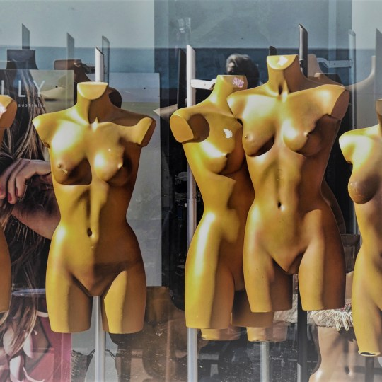 Female mannequins lined up in a shop window