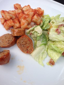 Gnocchi in fresh tomato sauce, sausage and caesar salad with homemade croutons