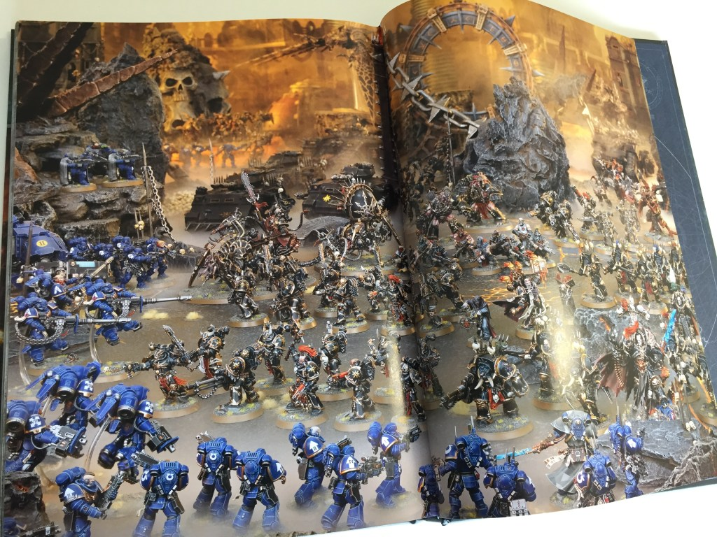 Black Legion forces assault a gunline of Primaris Ultramarines.