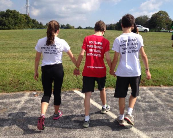 Vince and Rhonda helping Victor as they prepare for the TACA PA Run to support more families