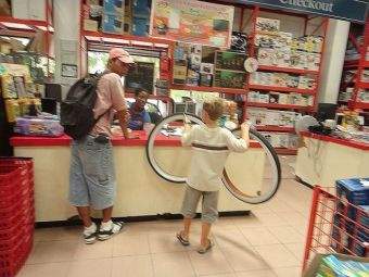 buying whitewall bicycle tires for my beach cruiser from Castillos Hardware San Pedro Belize