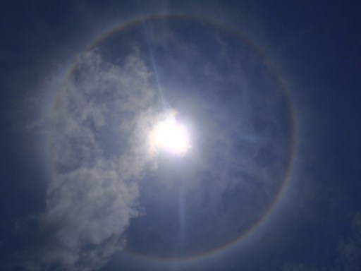 high altitude Cirrus clouds and solar halo