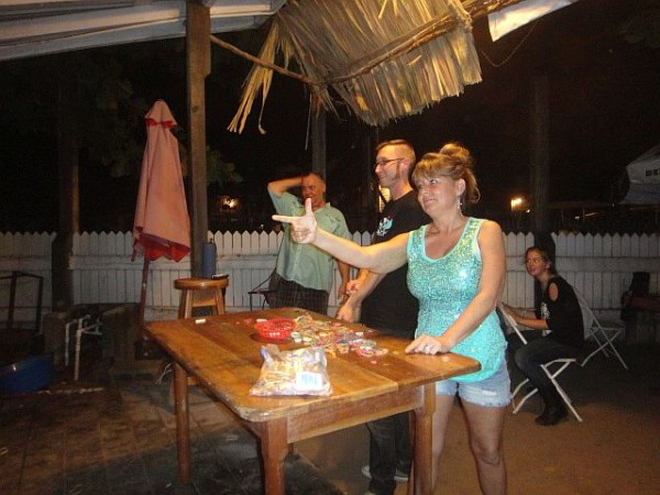 Brian McGuire playing Minute to Win it at Roadkill Bar Belize