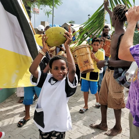 Belize boy with a coconut