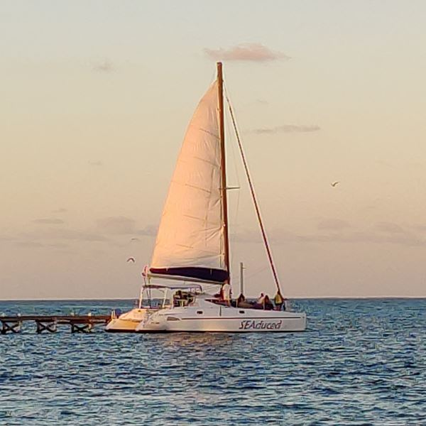 Sunset catamaran cruise celebrating Belize in December
