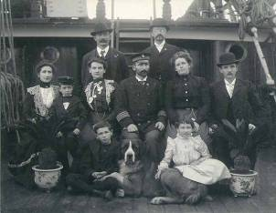 Captain Zingler and his family and friends on the deck of the three-masted German sailing vessel FLOTTBEK at Tacoma Washington in 1902.Every sailing family needs a pet Saint Bernard and a couple potted breadfruit.