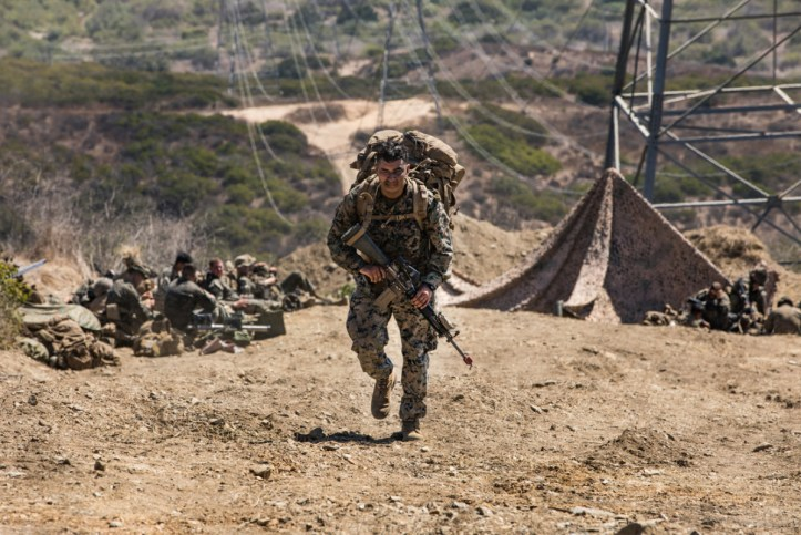 US Marine hiking, wearing MARPAT camouflage.