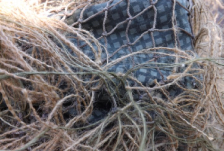 burlap string attached to netting on ghillie suit