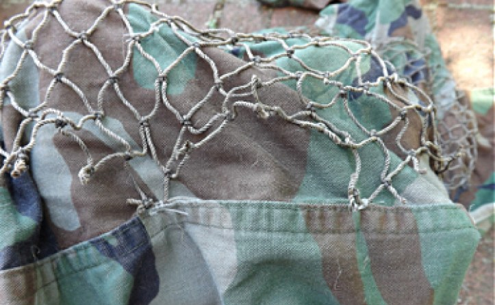 Ghillie suit netting attachment points.
