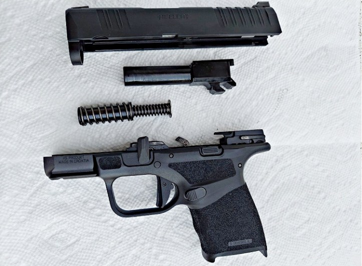 Springfield Hellcat 9mm micro-compact pistol, field stripped.