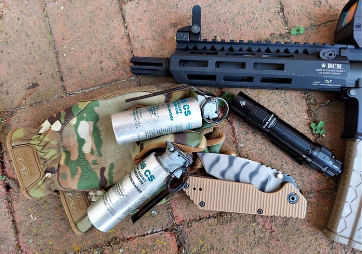 Fenix PD36 Tactical flashlight with other tactical gear.