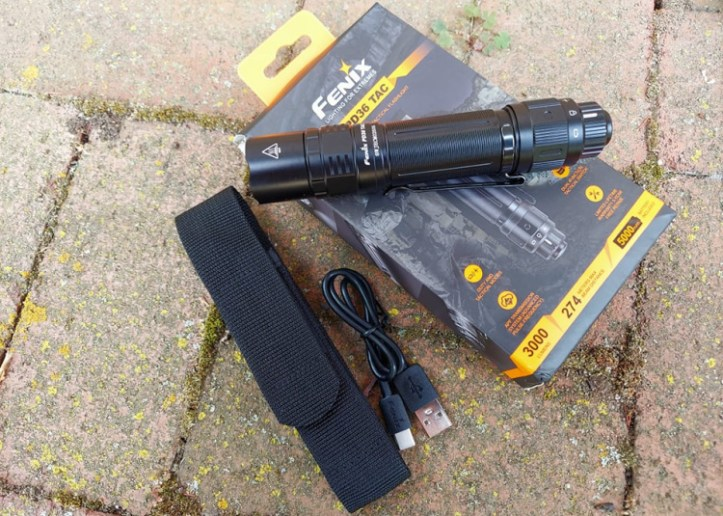 Fenix PD36 tactical flashlight with nylon belt holster and charger calbe.