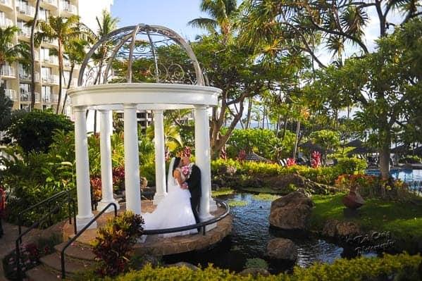 bride and groom kissing under the Hale Aloha Gazebo at the Westin Maui Resort & Spa