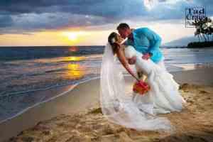 groom kissing bride at sunset on Maui, Hawaii