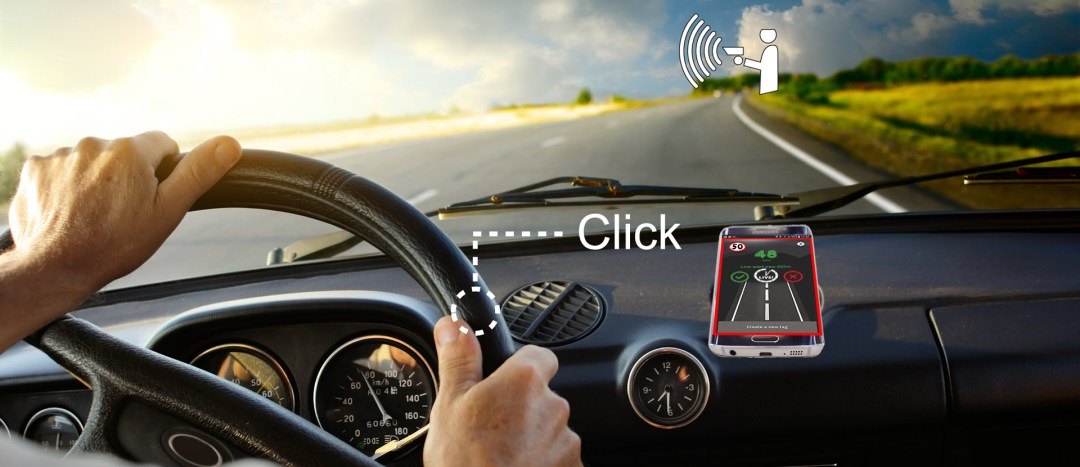 TagAcam SmartButton installed on car showing alert
