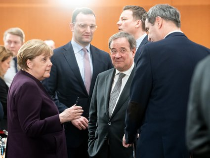 Social distance: Angela Merkel first has to forego contact with her cabinet colleagues.