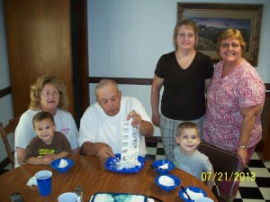 """""""Blood Brothers"""" members celebrating with cake and ice cream in July."""