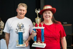 "Pat Bullins (Barney chapter, Greensboro, N.C.) holds her latest First Place trophy from the Mayberry Days Trivia Contest. Dennis Beal (Mayberry chapter, Knoxville, Tenn.), himself a multi-time champ of this esteemed ""Super Bowl of Mayberry Trivia,"" holds his Second Place trophy. Photo by Hobart Jones."