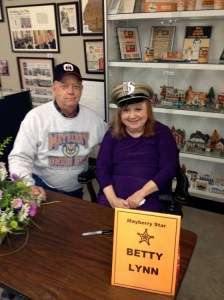 DON'T WEAR MY HAT, THEL!--Barney chapter's Ted Womack with Betty Lynn, who's wearing his Mayberry Deputy hat during her autograph session at the Andy Griffith Museum on January 17.