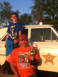 Jeff Gossett (front) and son Coy bask in the setting sun with their MSCN Obstacle Course hardware
