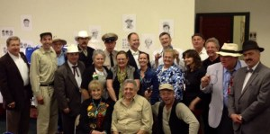 Maggie Peterson and Rodney Dillard (seated in front) are surrounded by tribute artists, festival organizers and fans at Mayberry in Midwest in Danville, Ind.